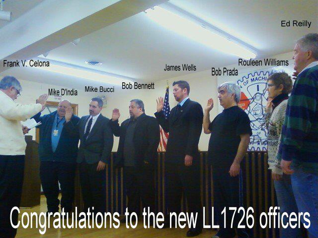 Retired Transportation Department Administrative Assistant Frank Celona swears in the new Executive Board of LL1726.